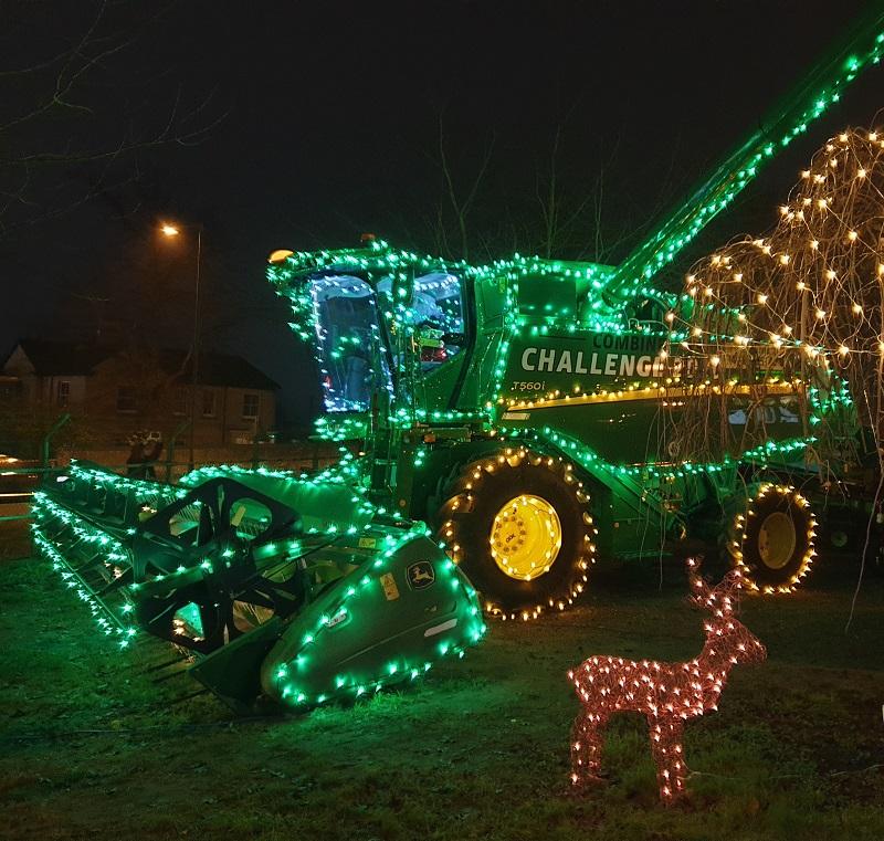 Combine Harvester in Christmas Ligts at Ben Burgess John Deere in Norwich