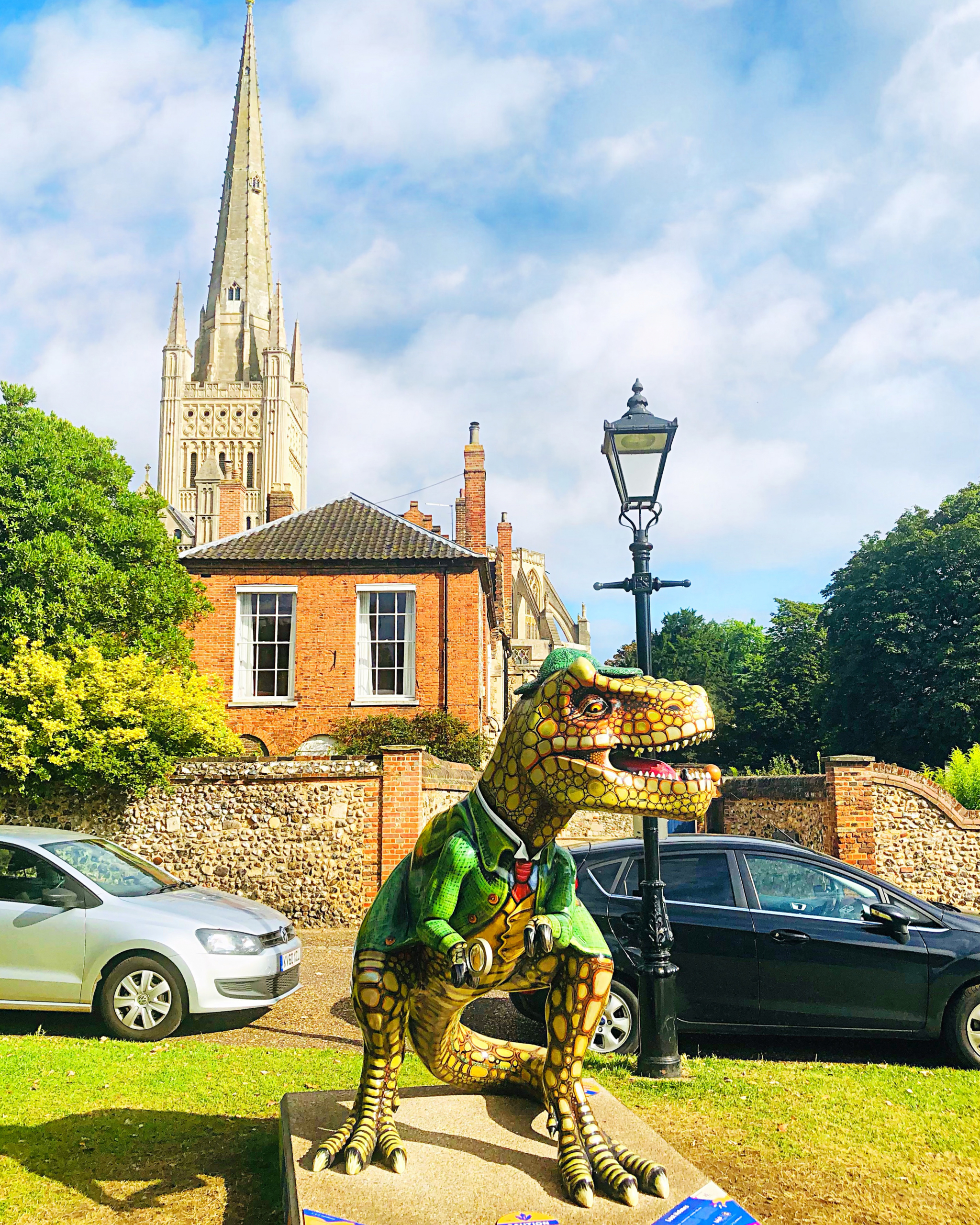 Lost Holmes T.rex sculpture with Norwich Cathedral in the background.